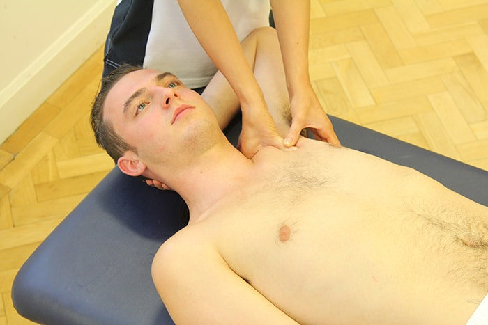 Decreased pain massage treatment on upper shoulder in Manchester clinic