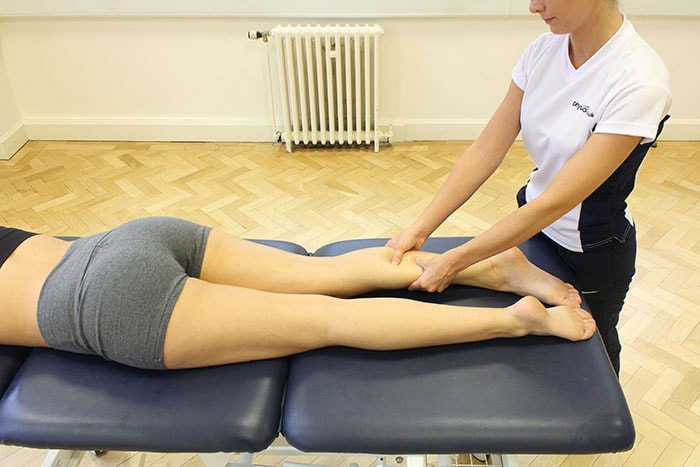 Deep Tissue Massage treatment on lower leg in Manchester clinic