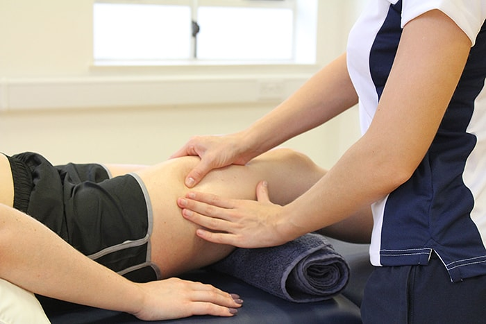 Delayed onset muscle soreness treatment on upper thigh in manchester clinic