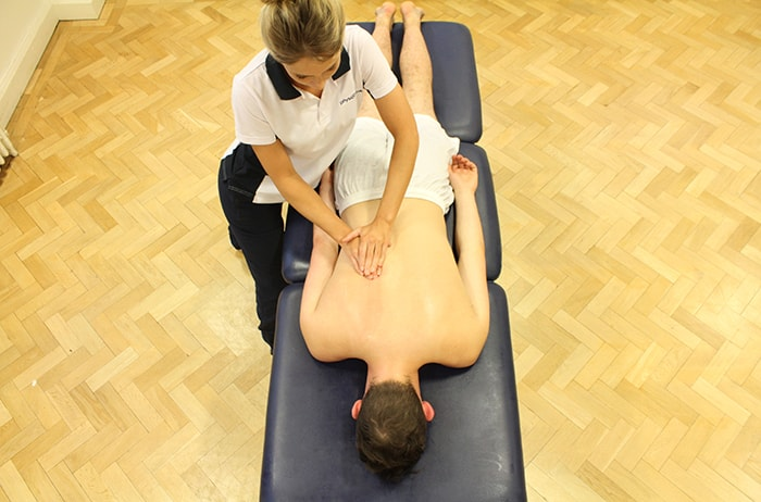 Effleurage massage technique on lower back in Manchester Clinic