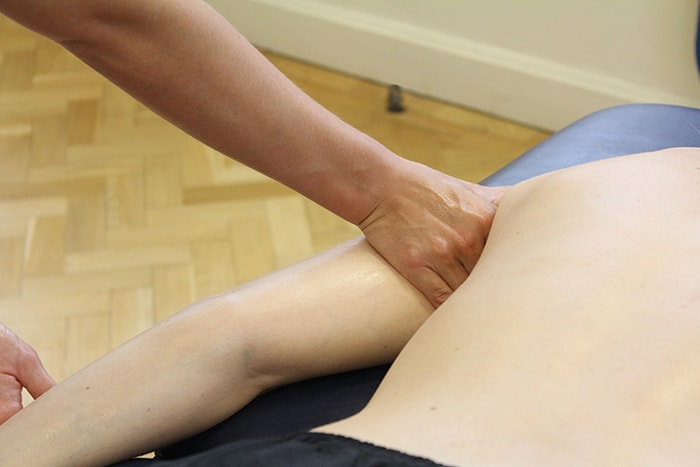 Lymphatic drainage massage technique on arm in Manchester clinic