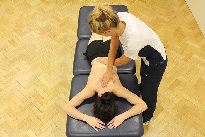 Myofascial release technique on customers back in Manchester clinic