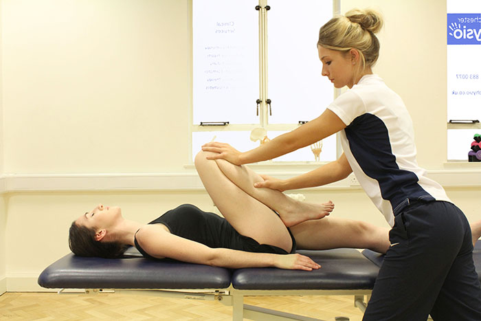 Post event massage treatment on upper leg in Manchester clinic