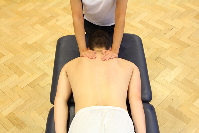 Swedish massage treatment on upper shoulders in Manchester clinic