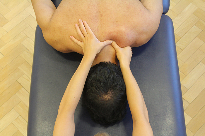 Trigger pointing massage technique in upper neck area in Manchester clinic