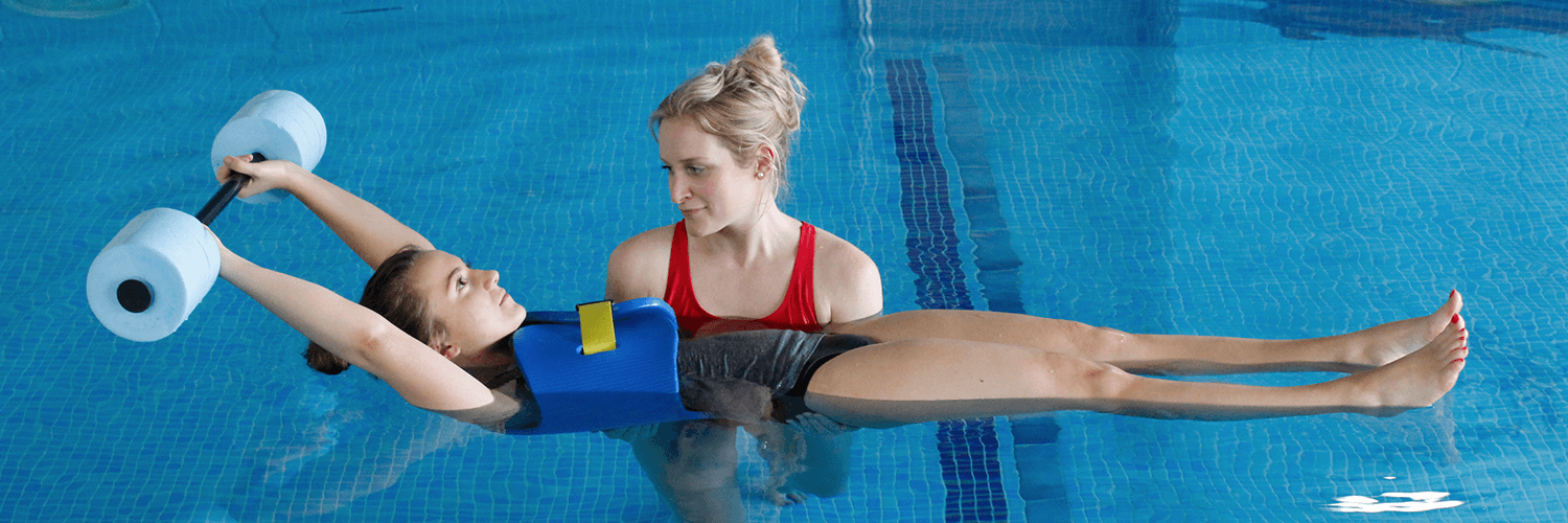 Female uses water aids to help recover in Hydrotherapy session.