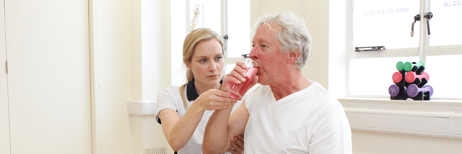 Elderly male recieves Neurological Physiotherapy treatment from experienced Manchester Physiotherapist.