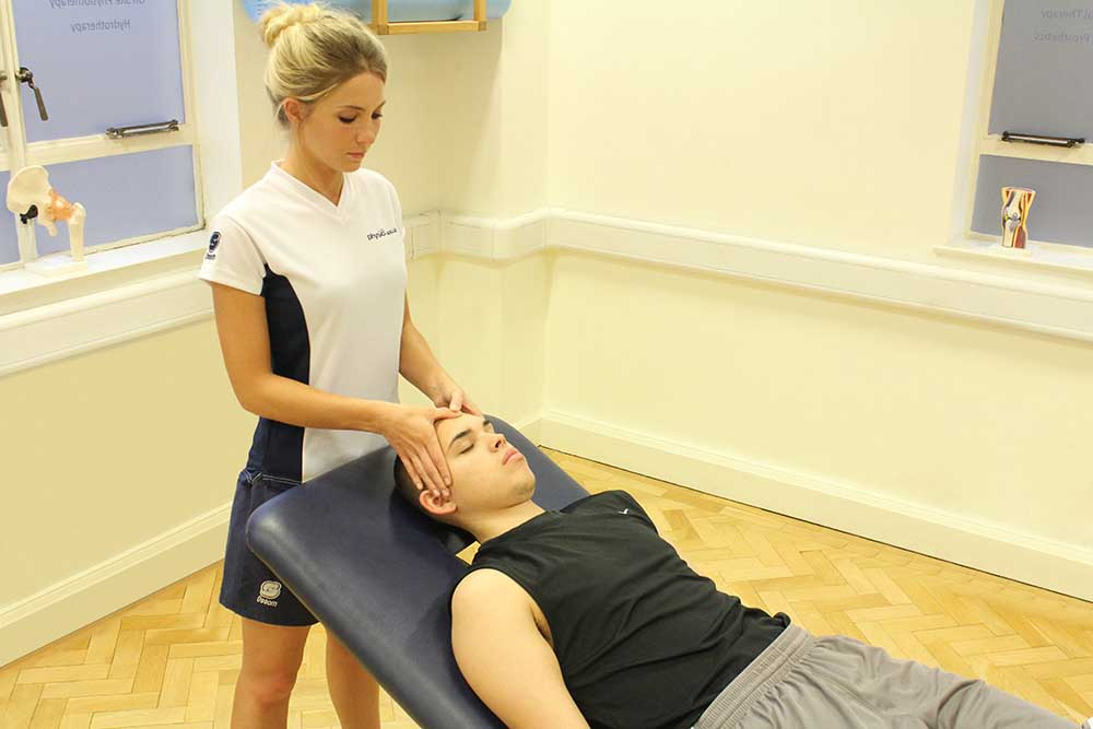 Accupressure massage technique applied to head
