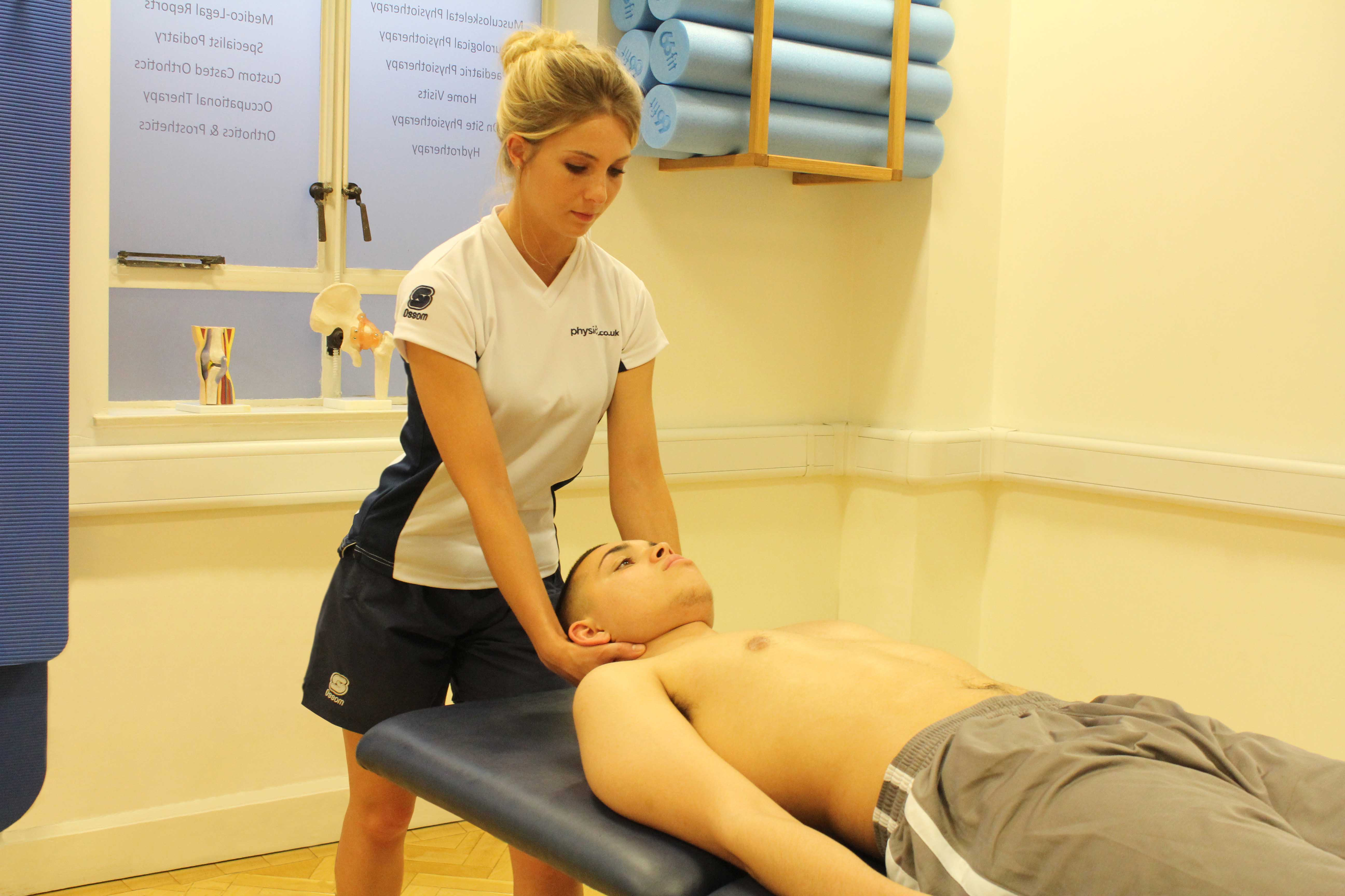 Mobilisation and stretches applied to the cervical spine by therapist
