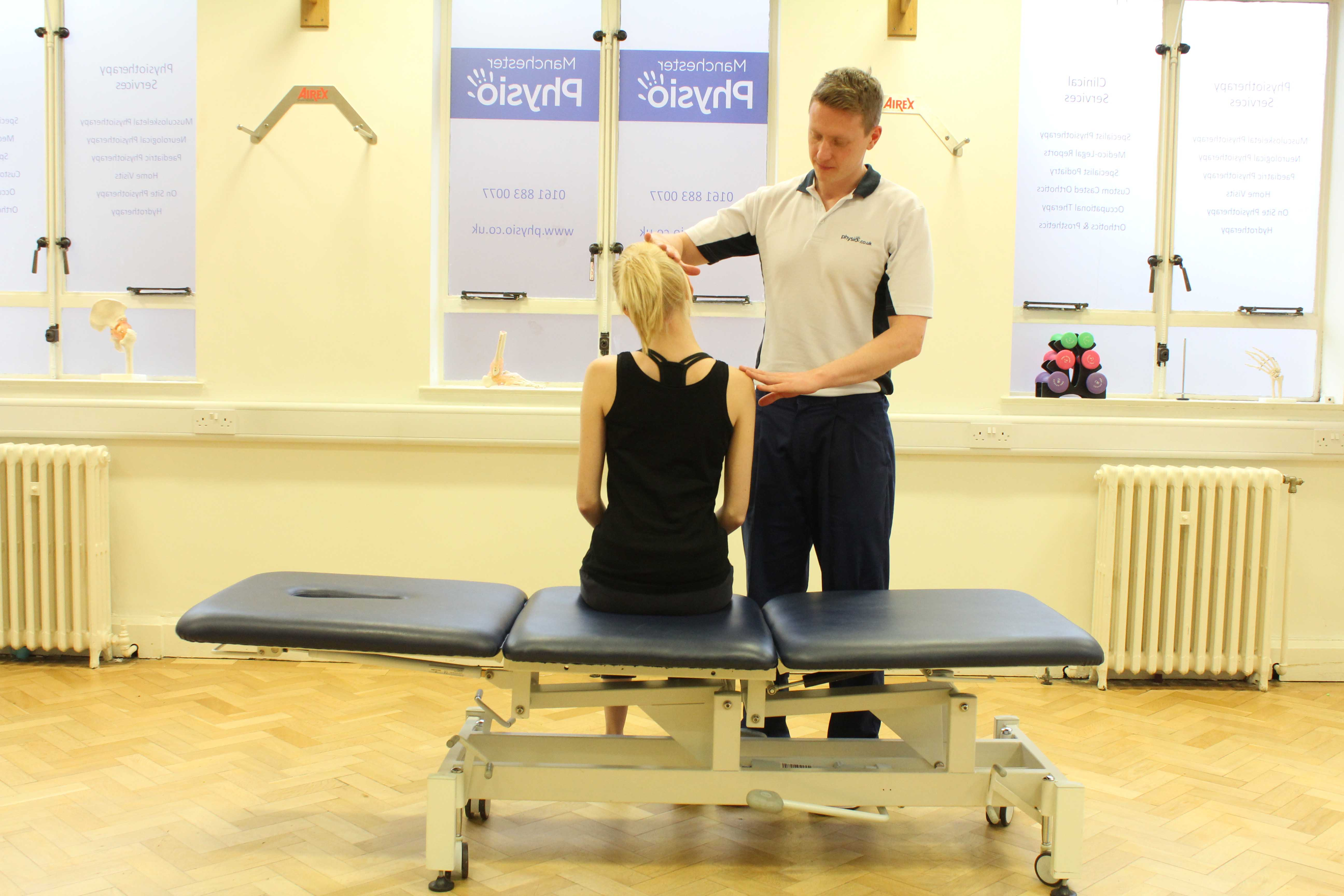 Experienced Physiotherapist conducting an assessment of the cervical spine, muscles and connective tissues in the neck