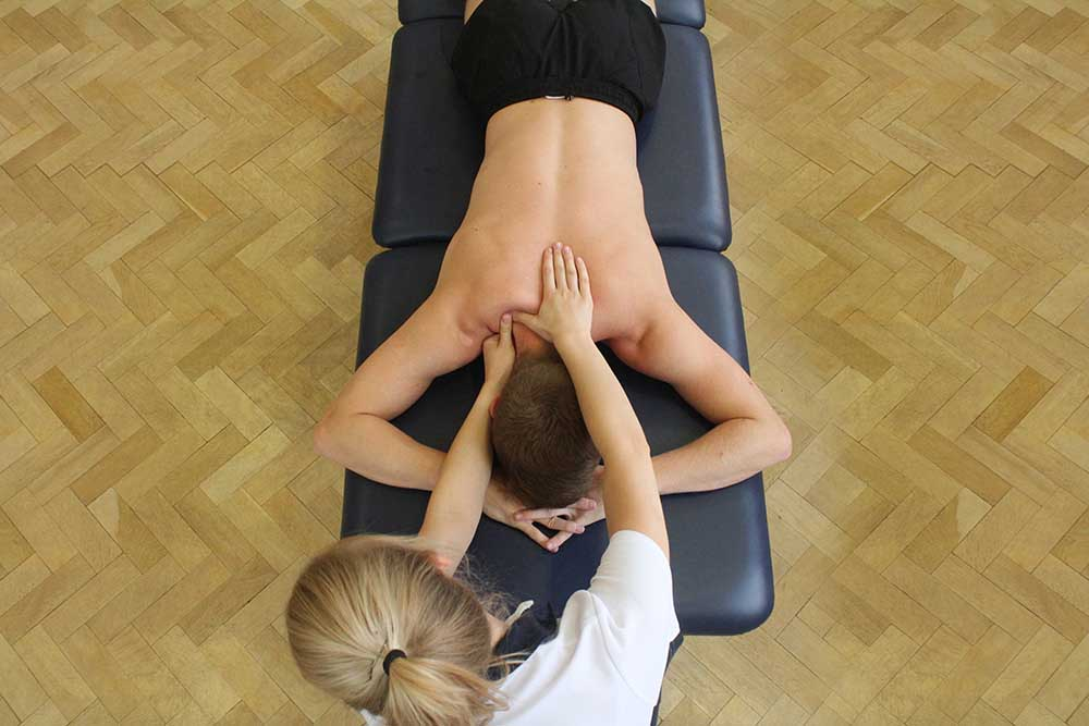Soft Tissue Massage targeting trapezius back muscles
