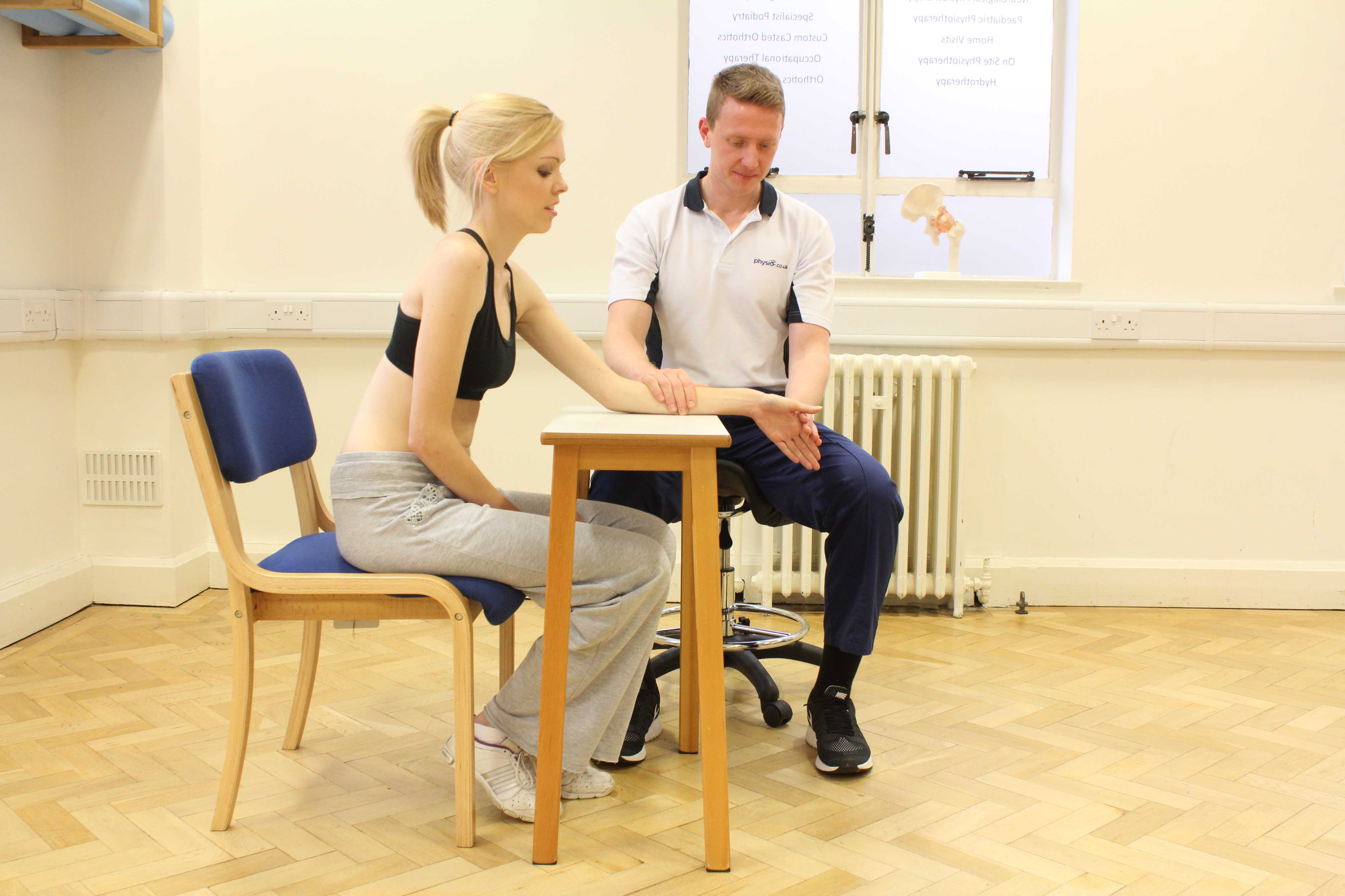 Physiotherapist assisted lateral deviation of the wrist stretches
