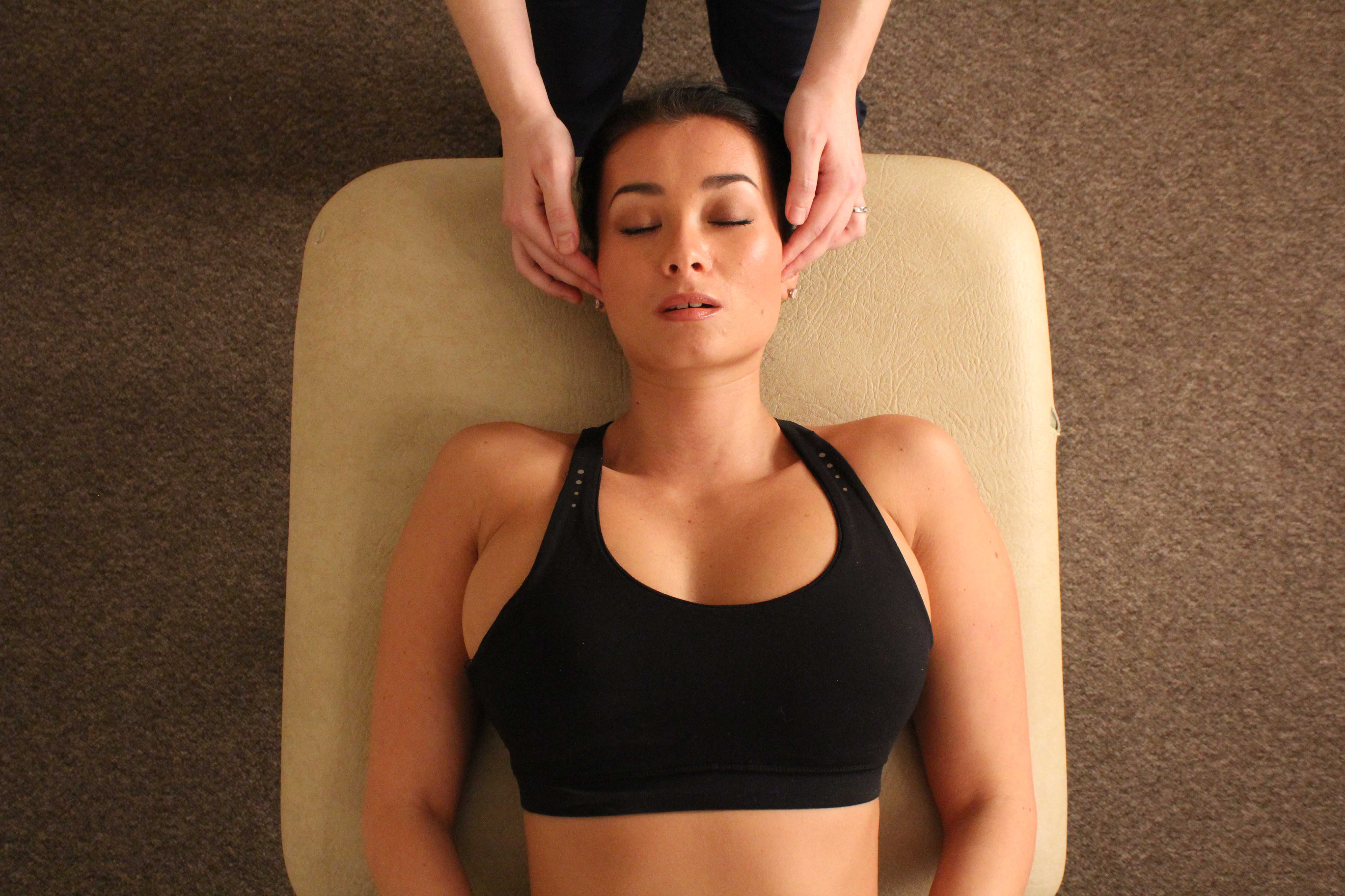 Soft tissue massage apllied to the head and face to releive aching and stimulate repair of muscular inervation