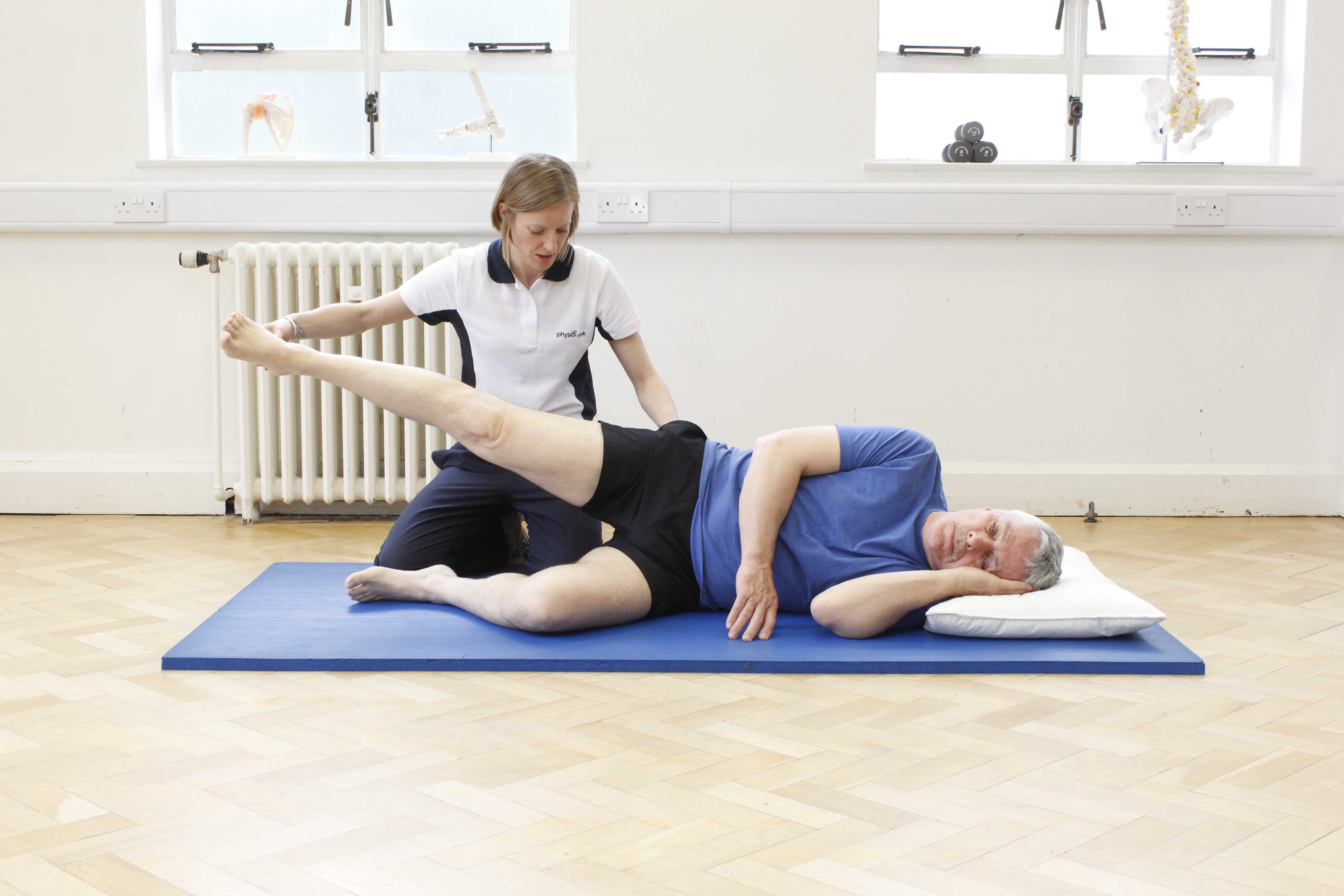 Hip abduction exercises supervised by a neurological physiotherapist