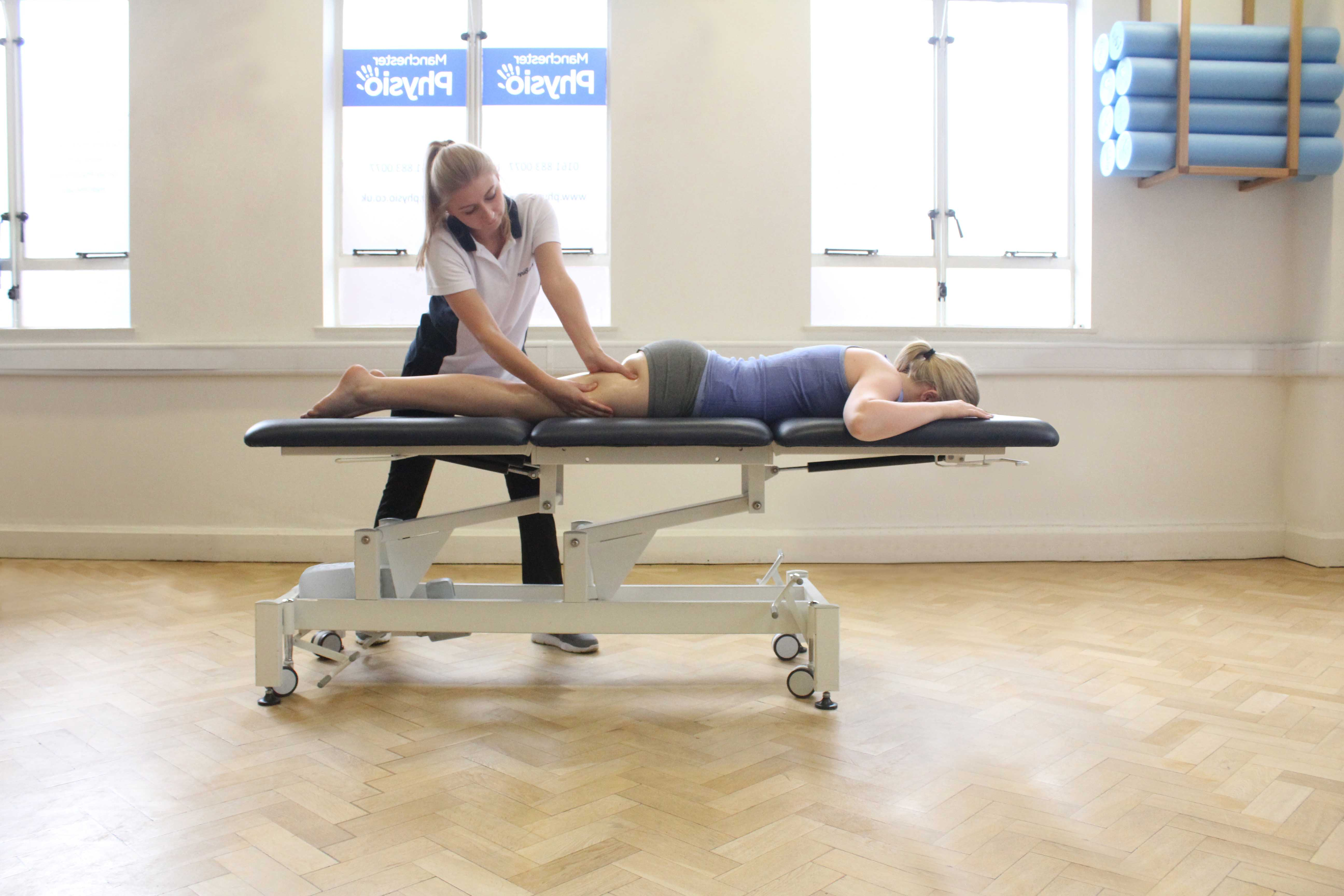 Deep tissue massage of the hamstring and gluteus muscles