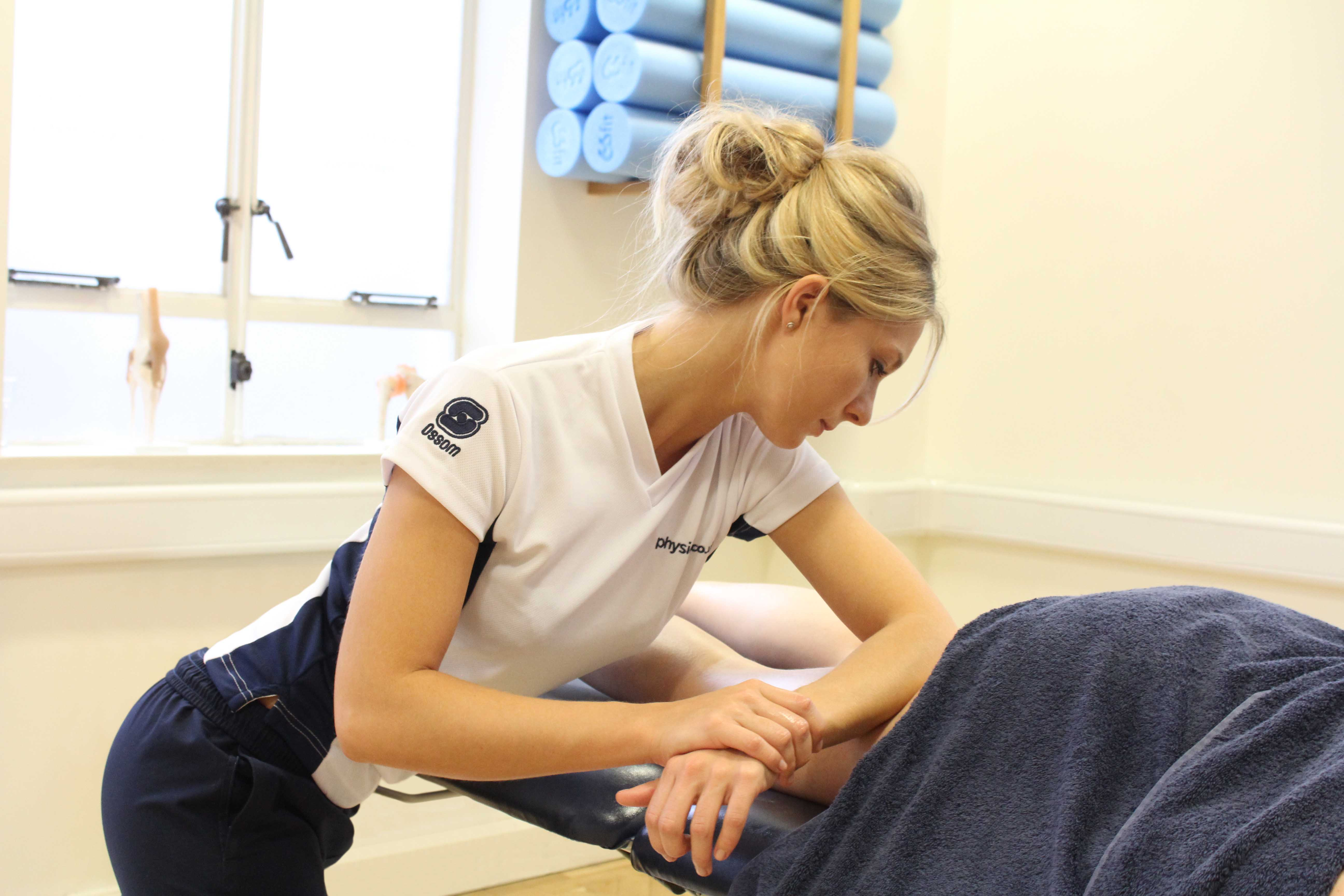 Deep tissue massage of the gluteus maximus muscle by specialist therapist