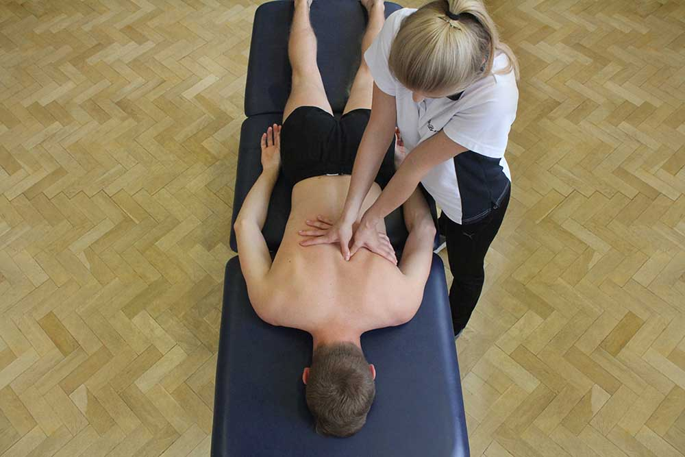 Trigger point massage into erector spinae muscle