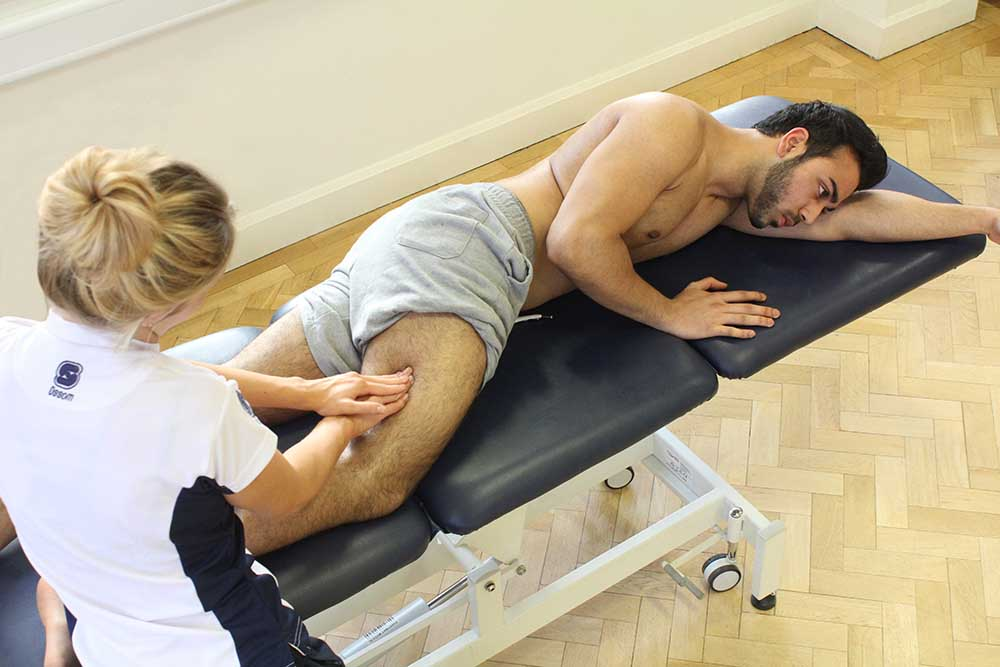Soft tissue massage of vastus lateralis and illio-tibial band