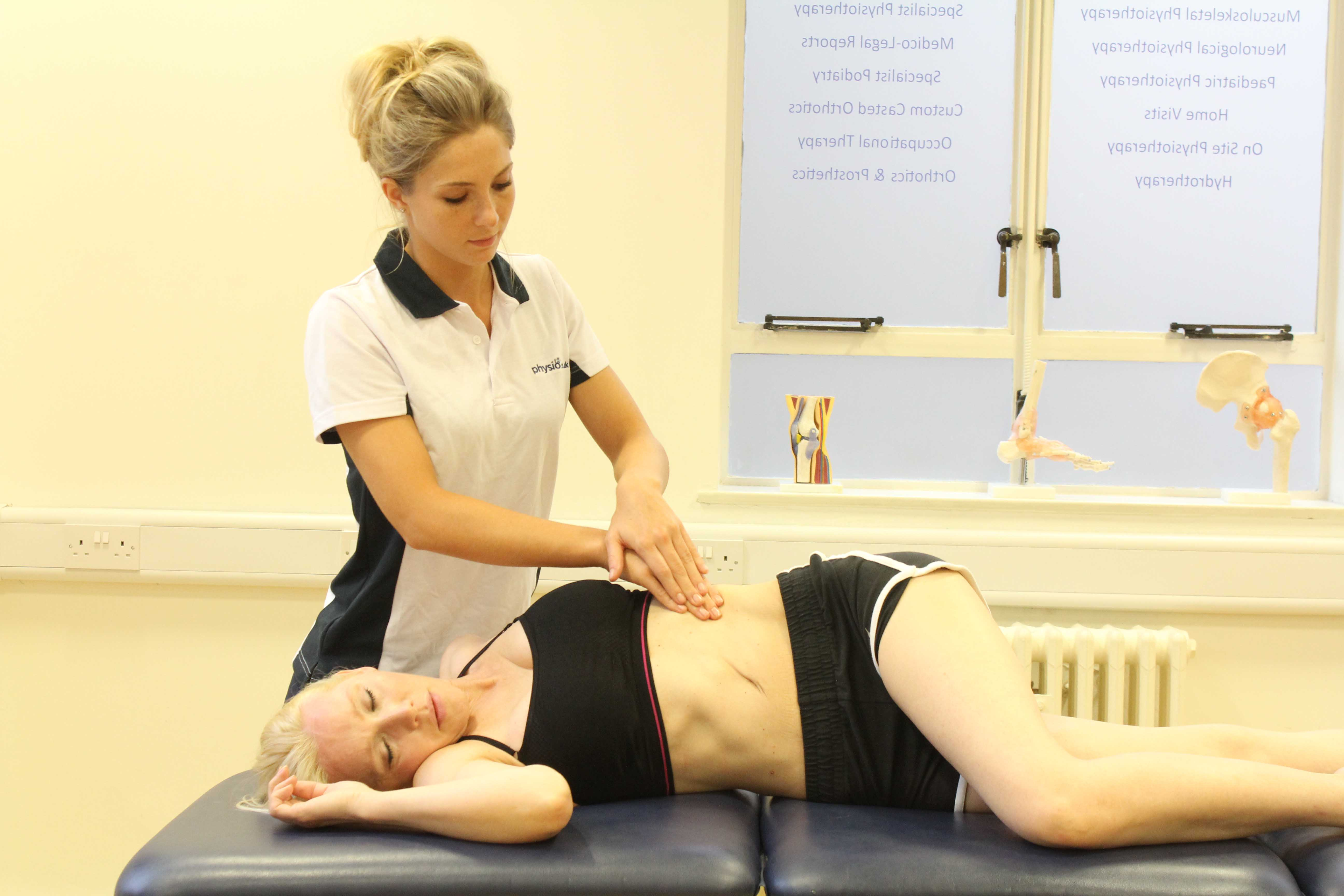 Soft tissue massage and stretch of the abdominal muscles by an experienced therapist