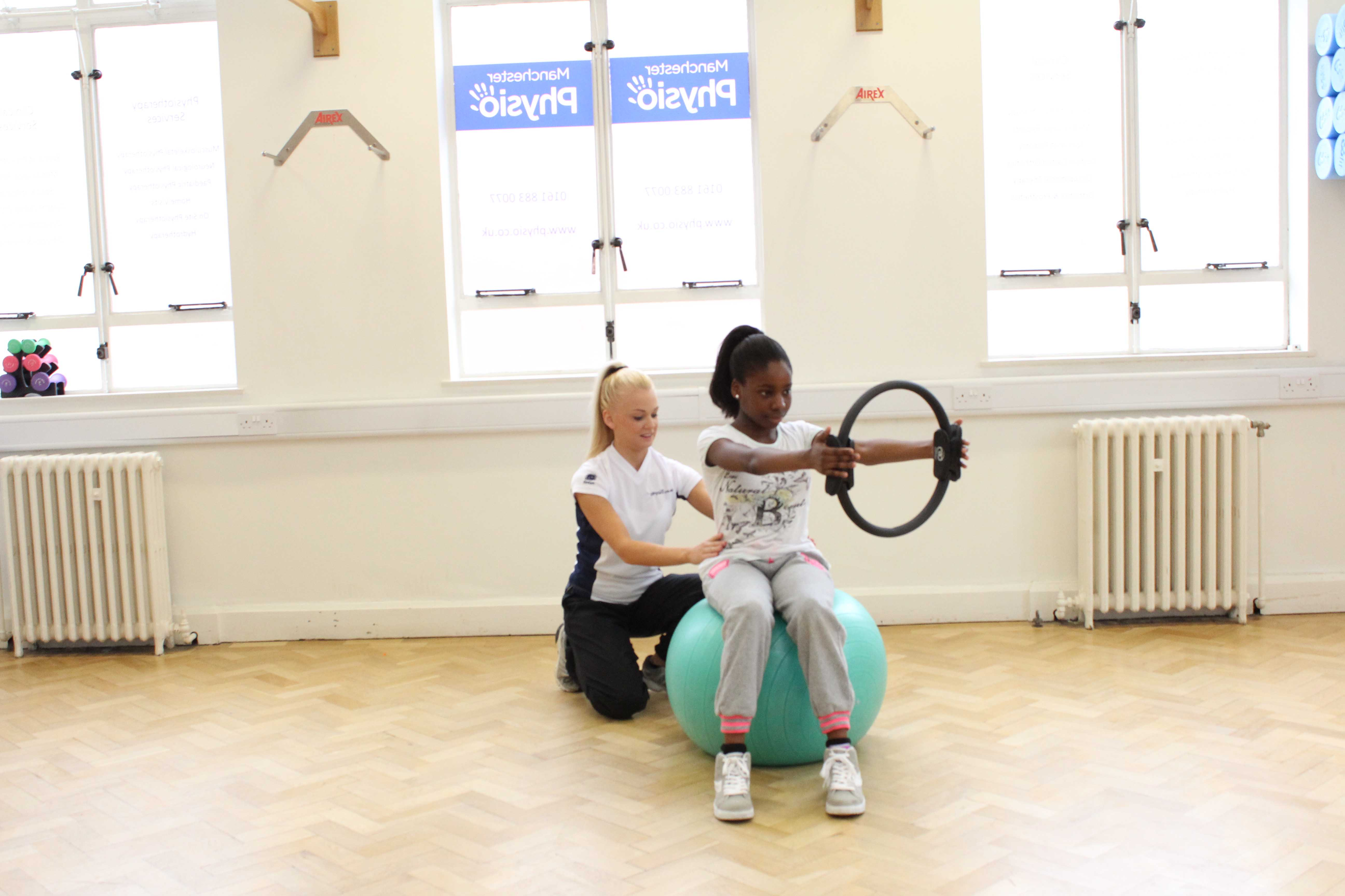 Core stability and stretching exercises supervised by a paediatric physiotherapist