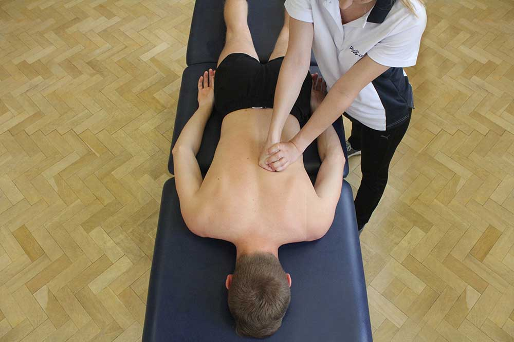 Kneading massage technique applied to Latissimus dorsi and erector spinae muscles