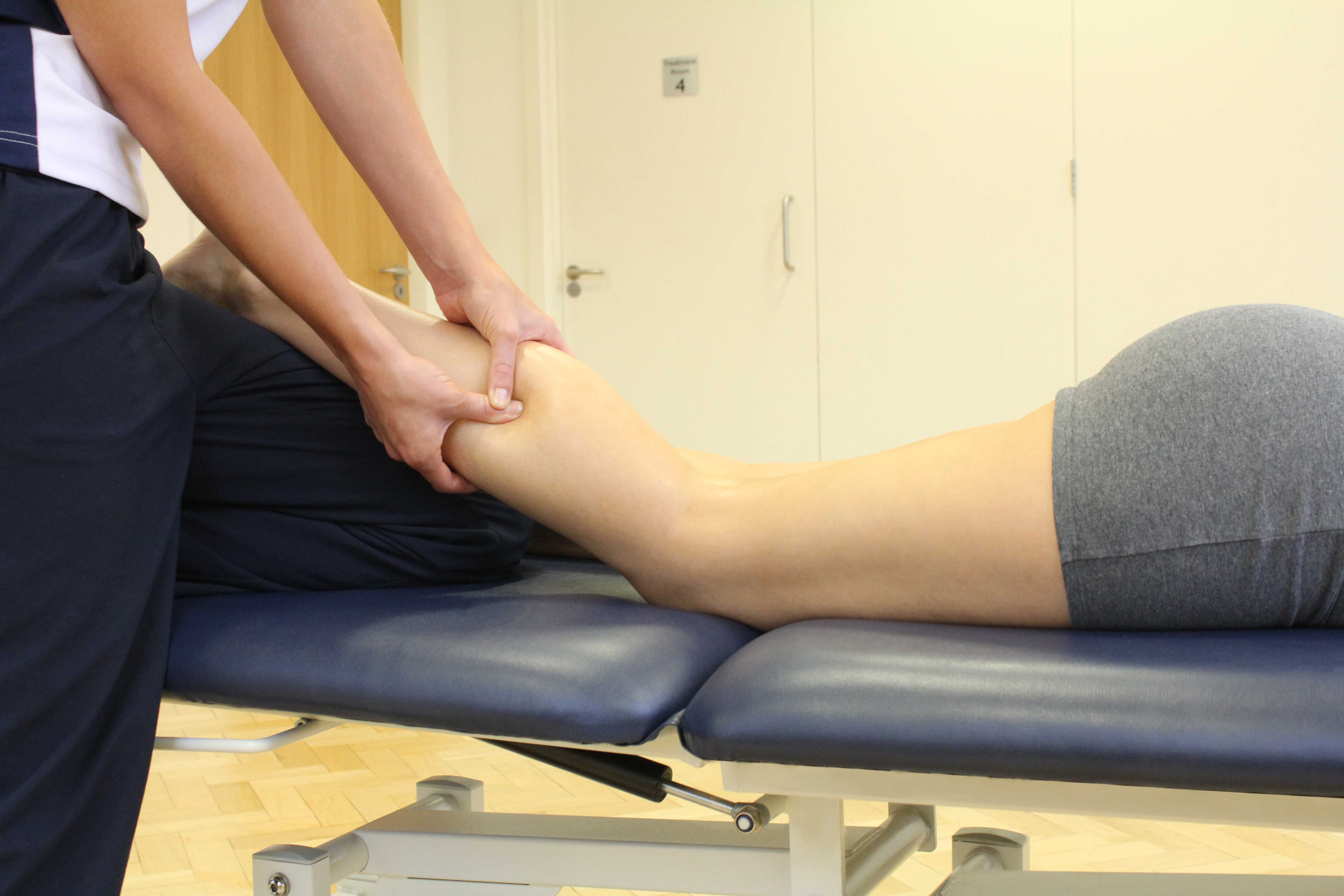 Trigger point massage applied to soleus muscle by specilaist therapist