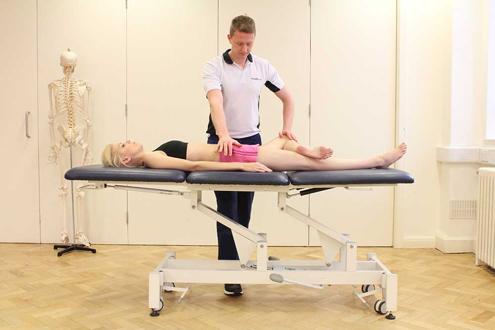 Passive stretches of the hip and pelvis performed by a senior musculoskeletal physiotherapsit