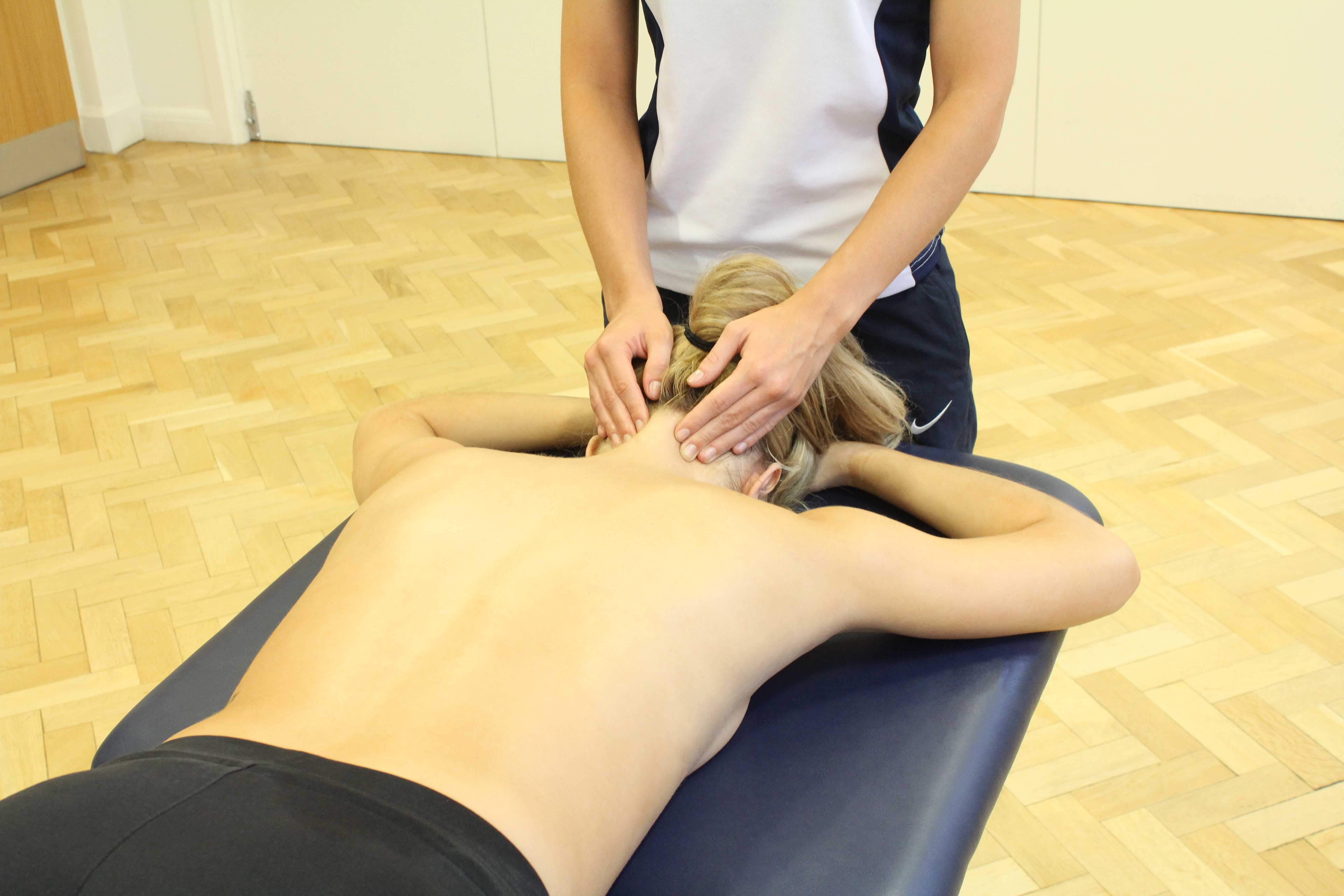 Massage and mobilisations of the trapezious muscles and cervical vertebrea to relieve pain and stiffness