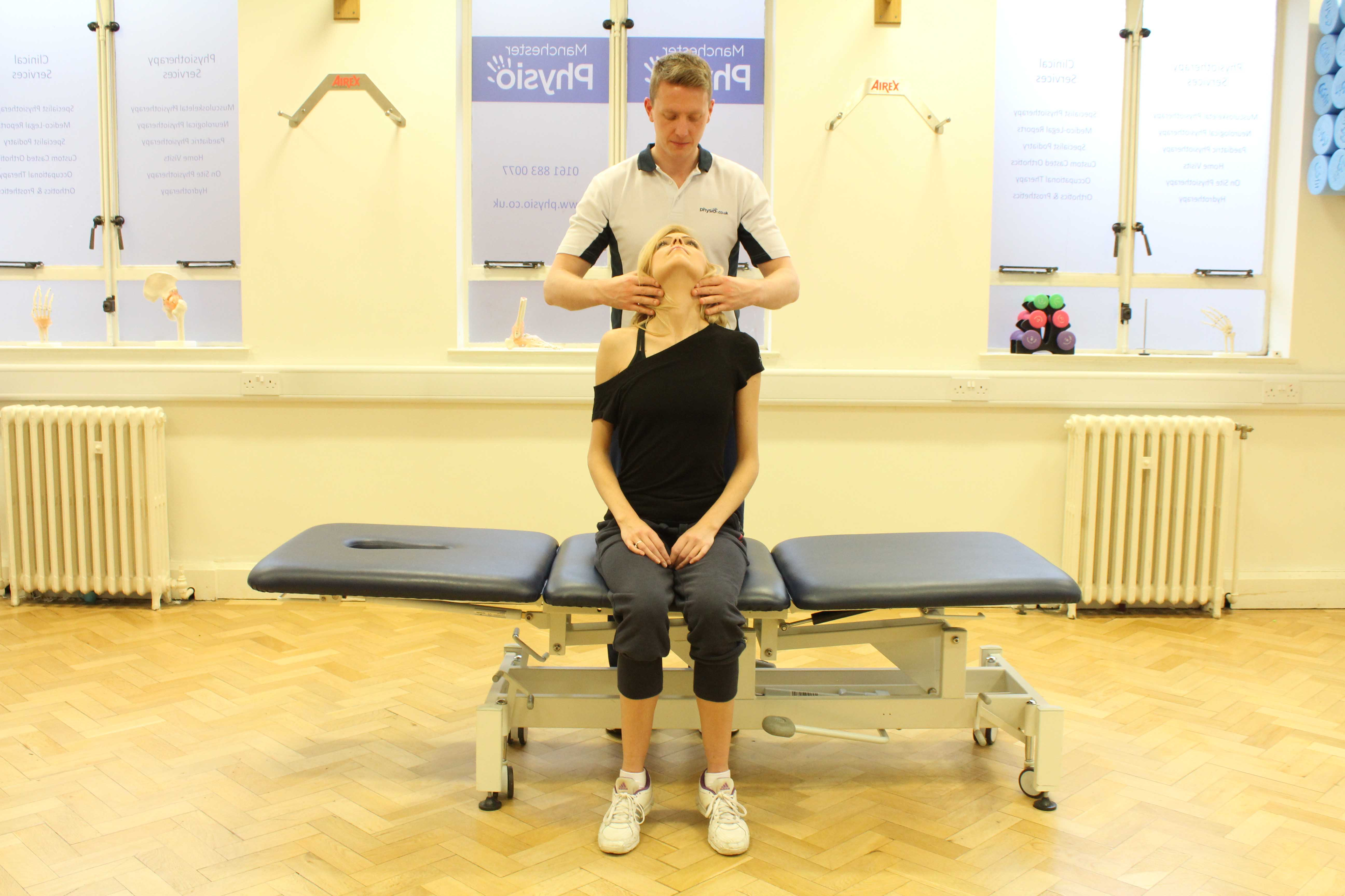Soft tissue massage of the muscle and connective tissues in the neck by specialist MSK therapist
