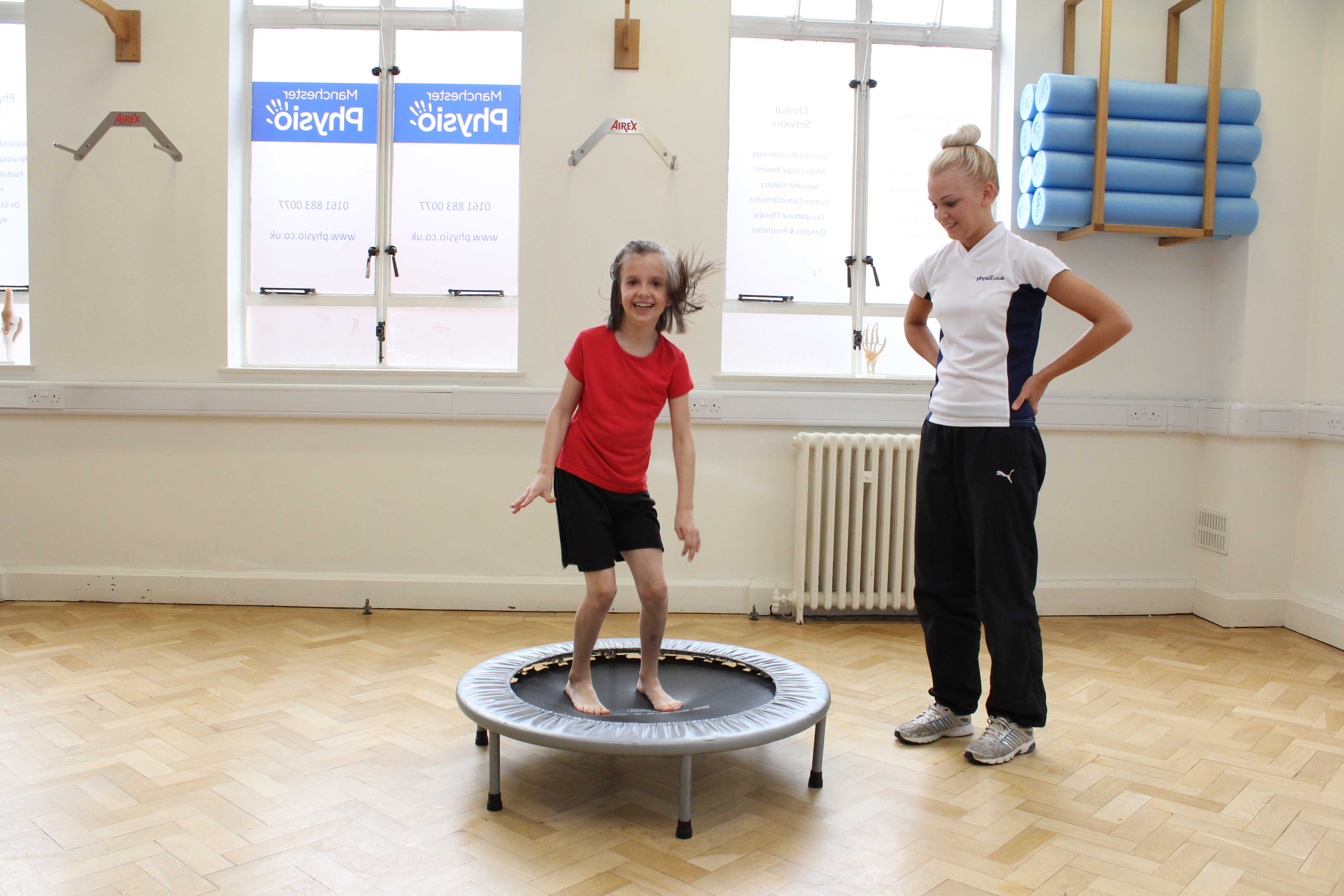 Core stability and toning exercises supervised by a paediatric physiotherapist