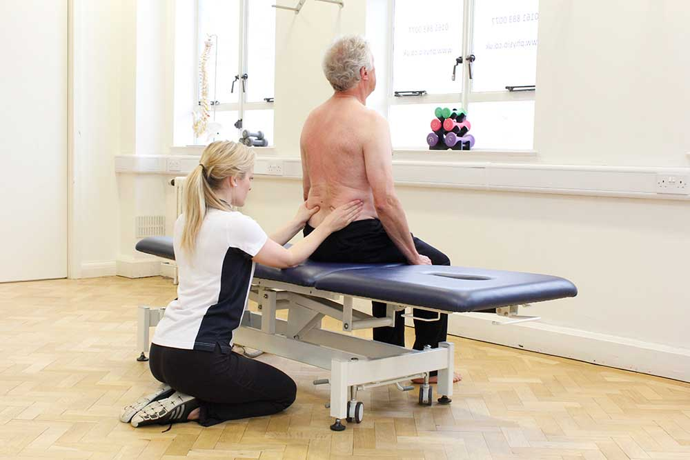 Postural correction to alleviate pain and stiffness assisted by a phyiotherapist