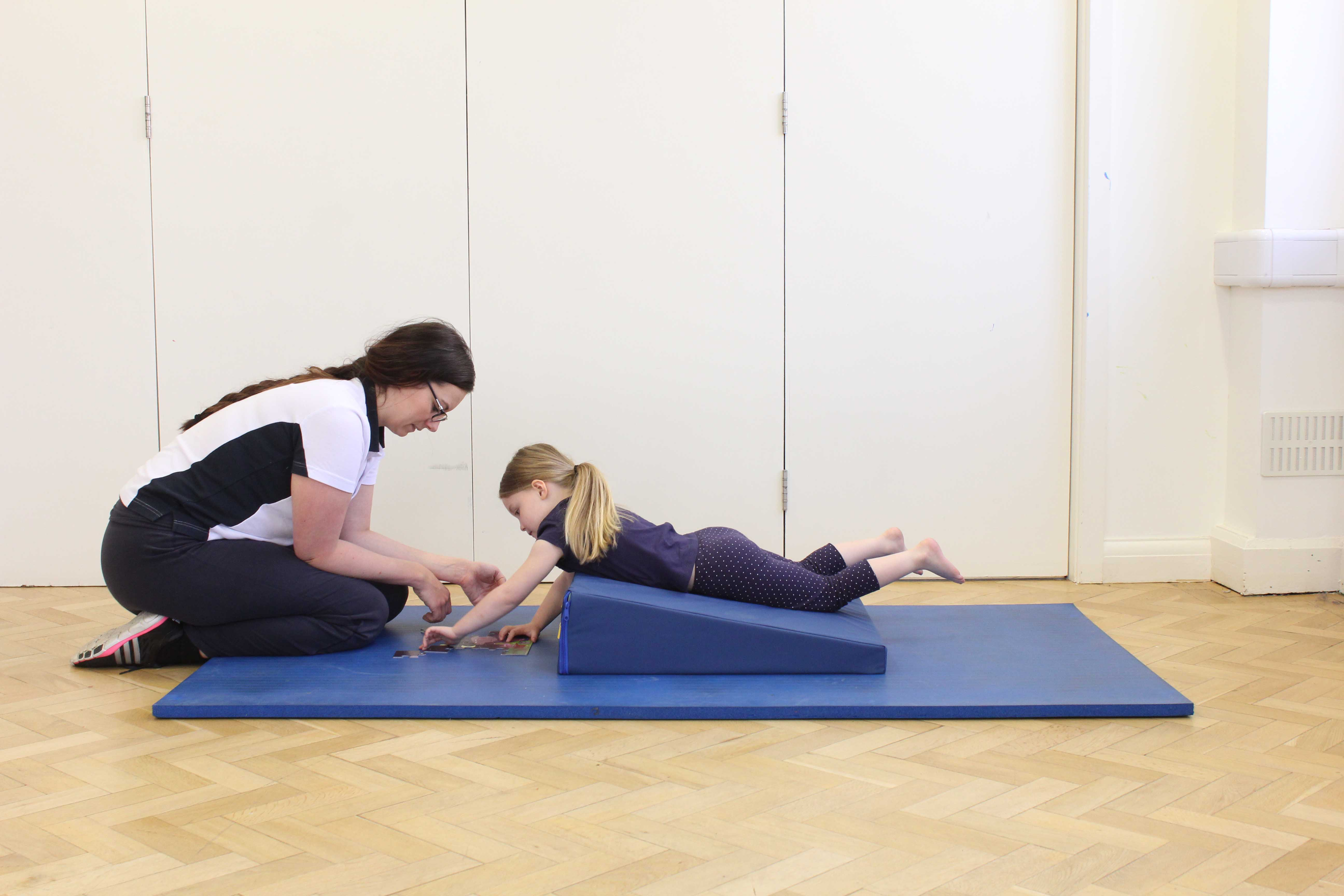 improving posture and raising muscle tone through play activity with a paediatric physiotherapist