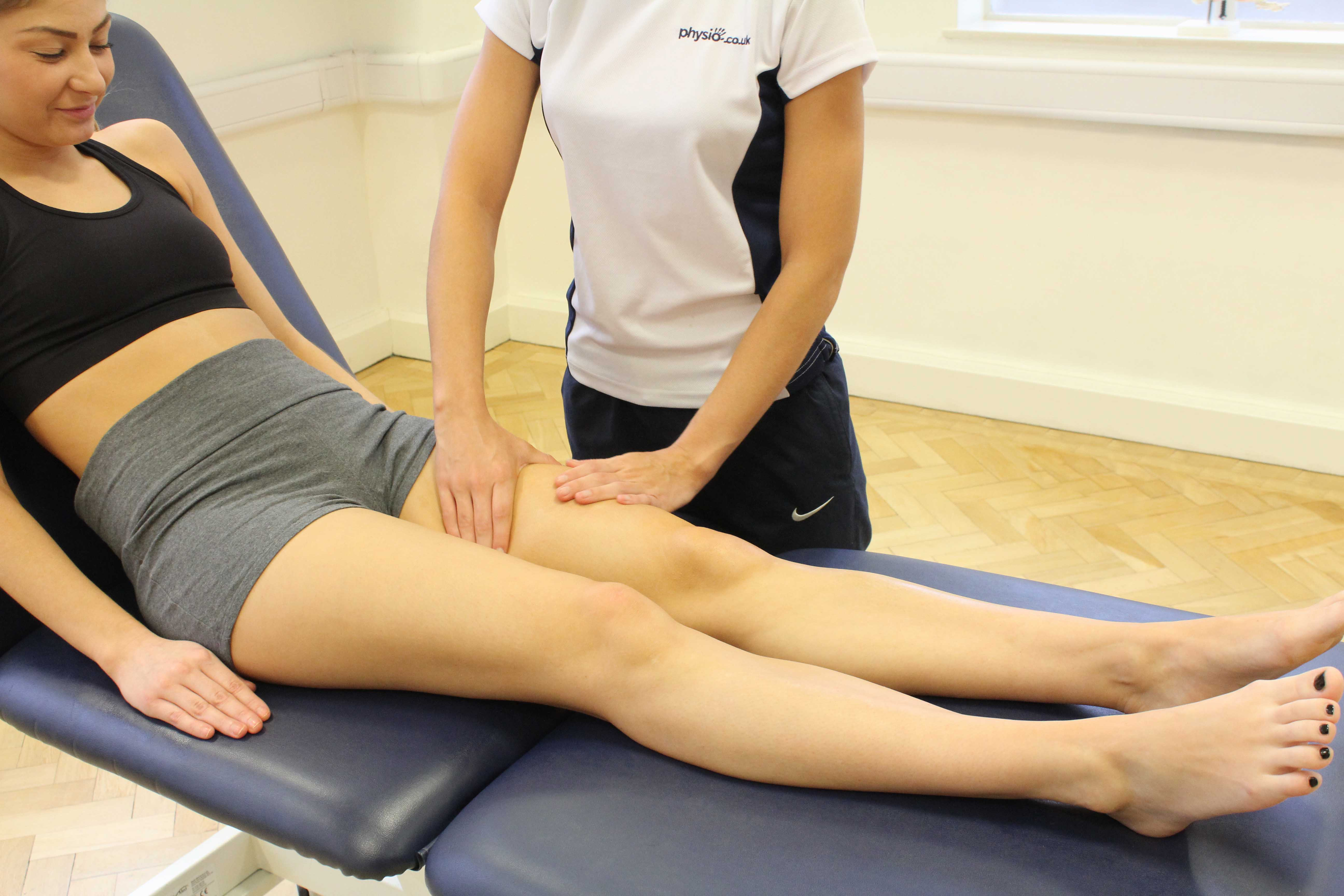 Rolling soft tissue massage of the quadricep muscles