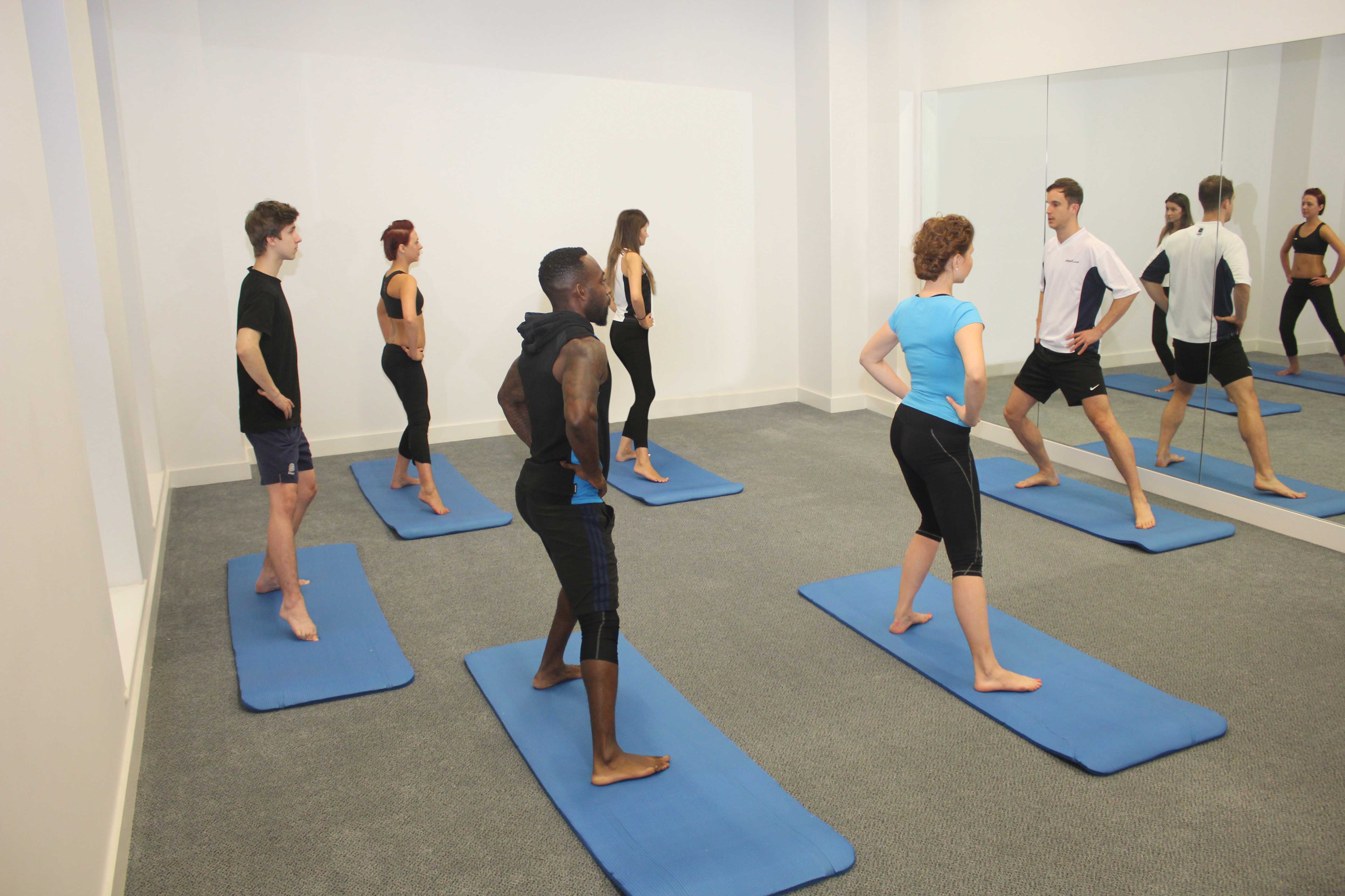 Hip abduction excercises using a resistence band supervised by a musculoskeletal physiotherapist