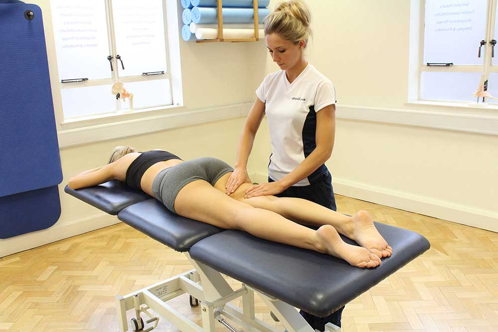 Rolling soft tissue massage of the hamstring muscles by a specilaist therapist