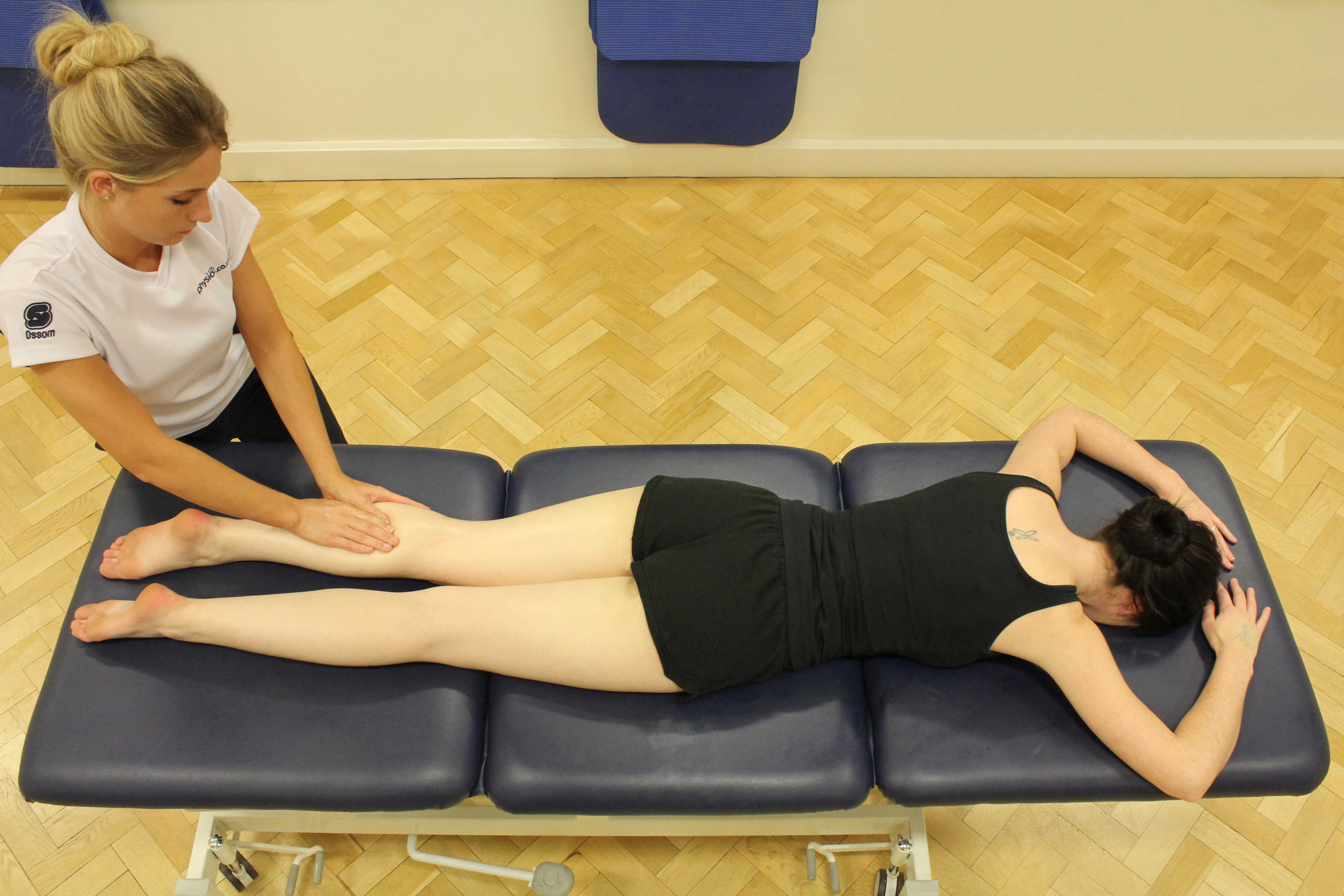 Soft tissue massage of the gastrocnemius muscle by an experienced therapist