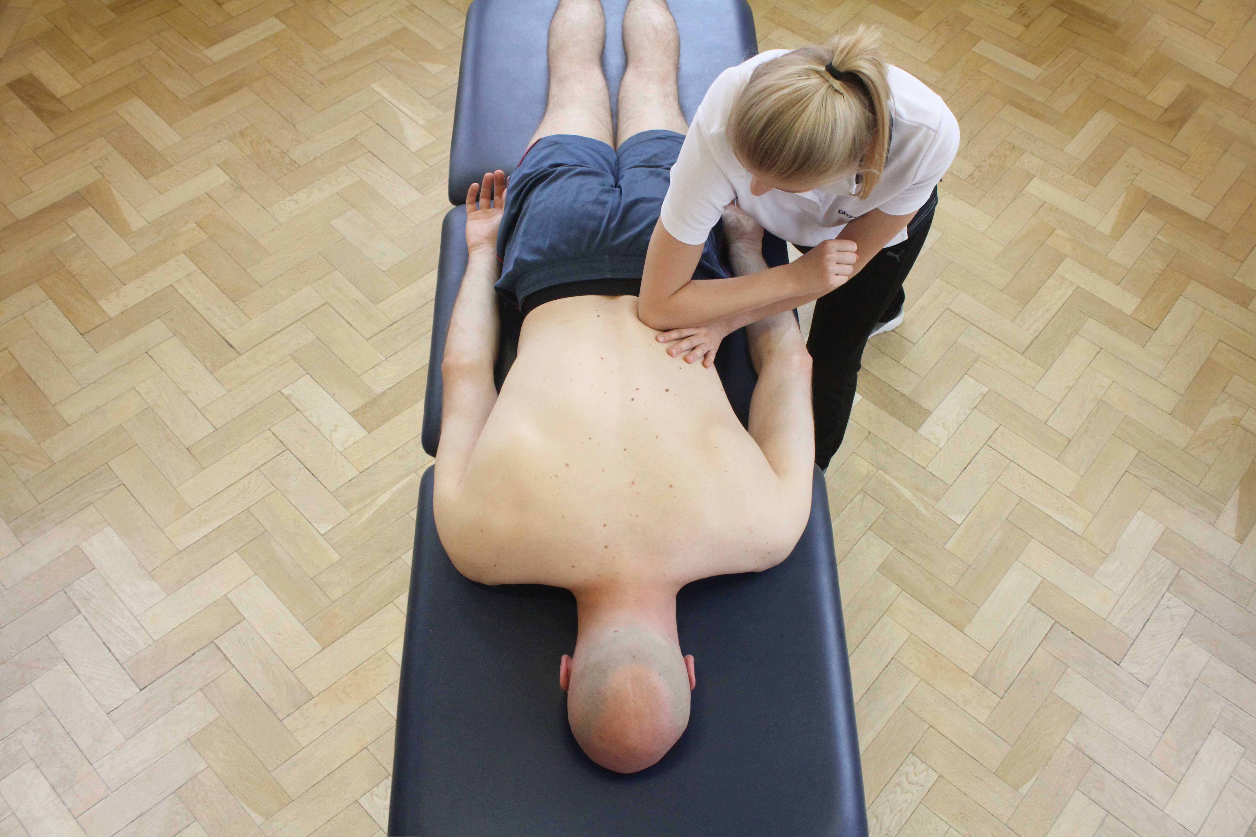 Deep tissue massage of the muscles in the lower back by specialist therapist