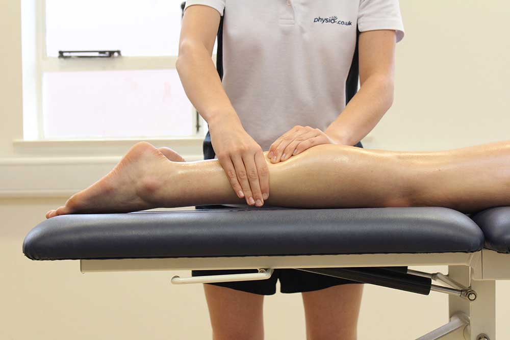 Rolling soft tissue massage of the gastroc nemius by a specilaist physiotherapist