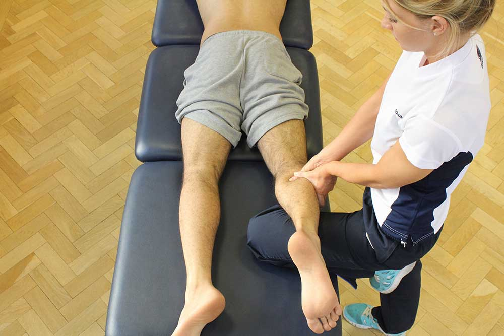 Trigger point massage of gastrocnemius to release knotted muscle and tightness