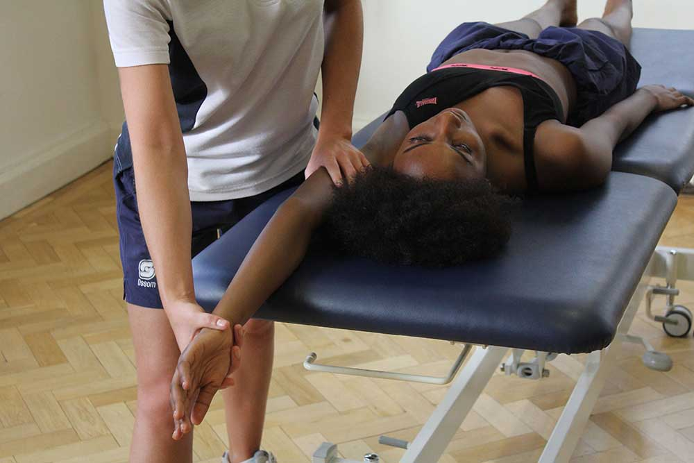 Massage and stretch of glenohumeral joint to ease tight muscles