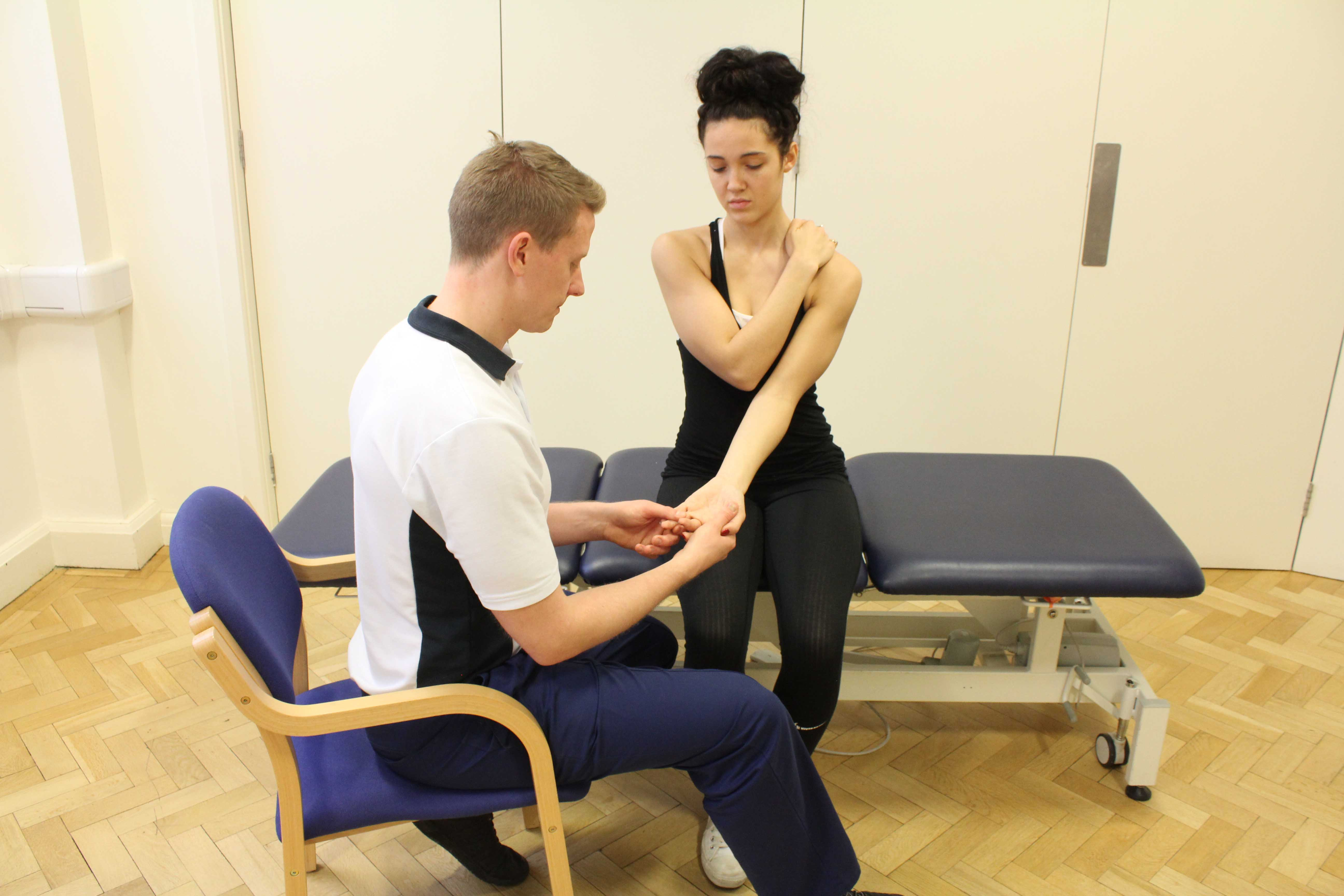 Examination of trigger finger, repetative strain injury by experienced physiotherapist
